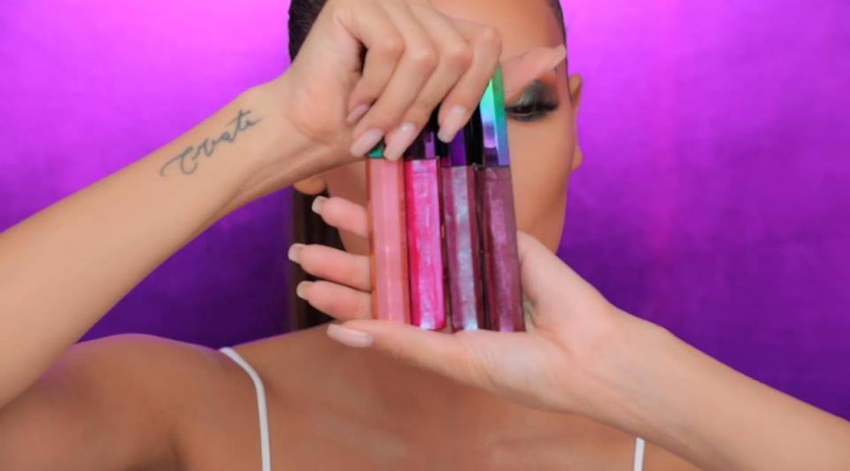 Desi Perkins shows the Cosmic Gloss Lip Glitters